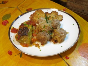 The main course: sweet and sour meatballs, potato latkes, and stuffed cabbage